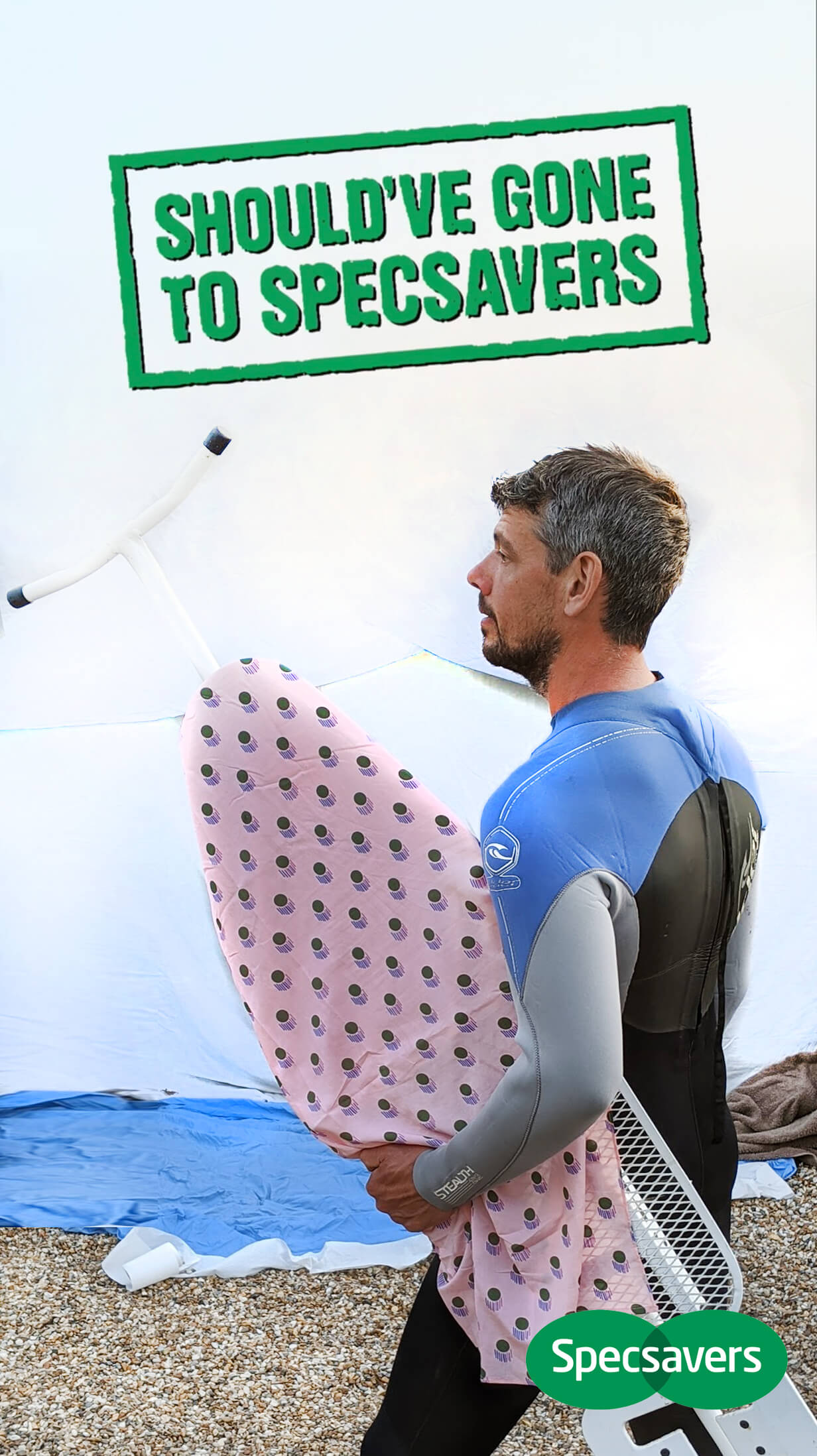 man holding ironing board
